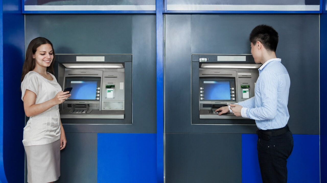 2 people using atm